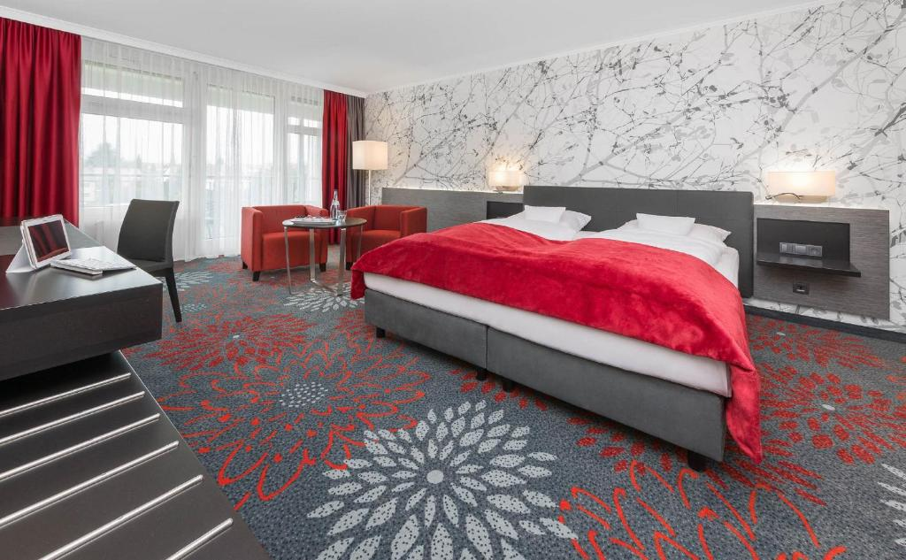 A bed or beds in a room at SI-SUITES