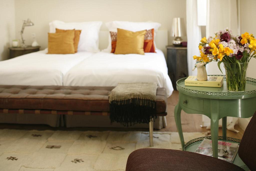 Cama o camas de una habitación en Casa das Janelas com Vista