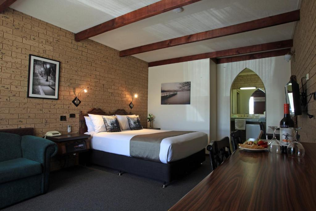 A bed or beds in a room at Belltower Motor Inn