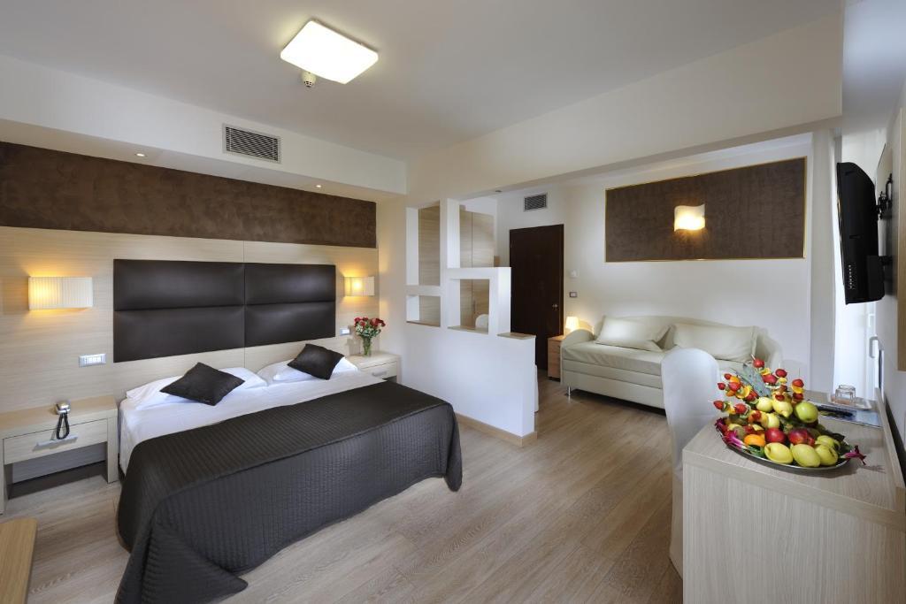 Letto o letti in una camera di Hotel Eros