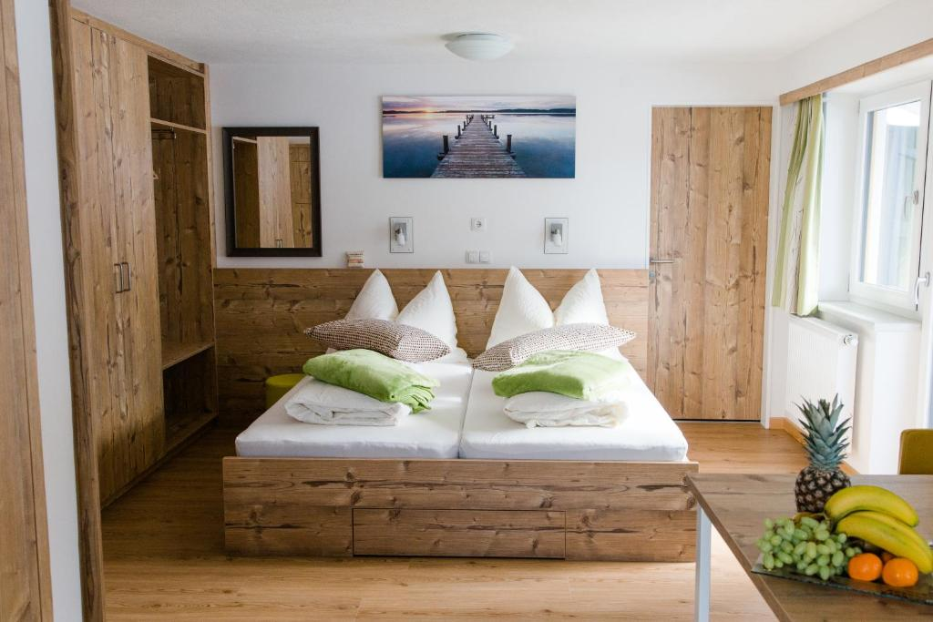 A bed or beds in a room at Haidegger Appartements