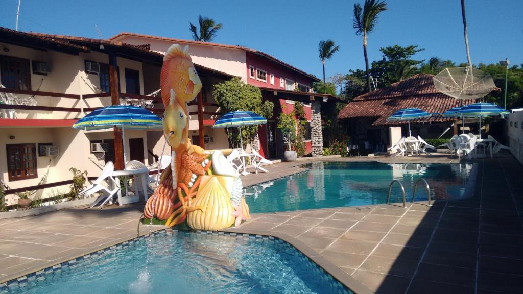 The swimming pool at or near Taperapuan Praia Hotel