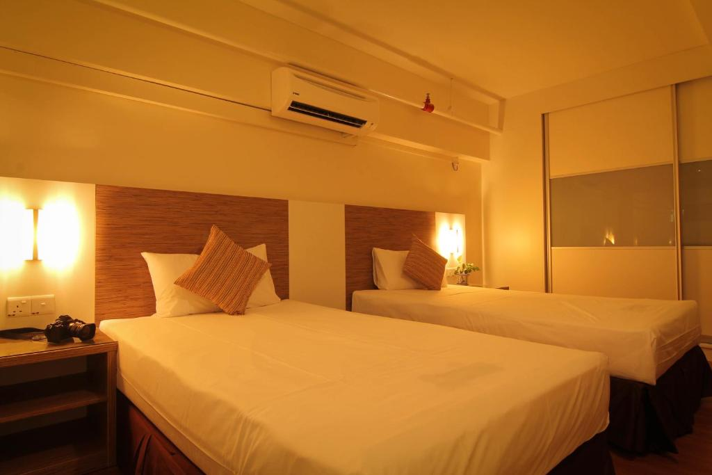 A bed or beds in a room at CEO ( Executive Office Suites )