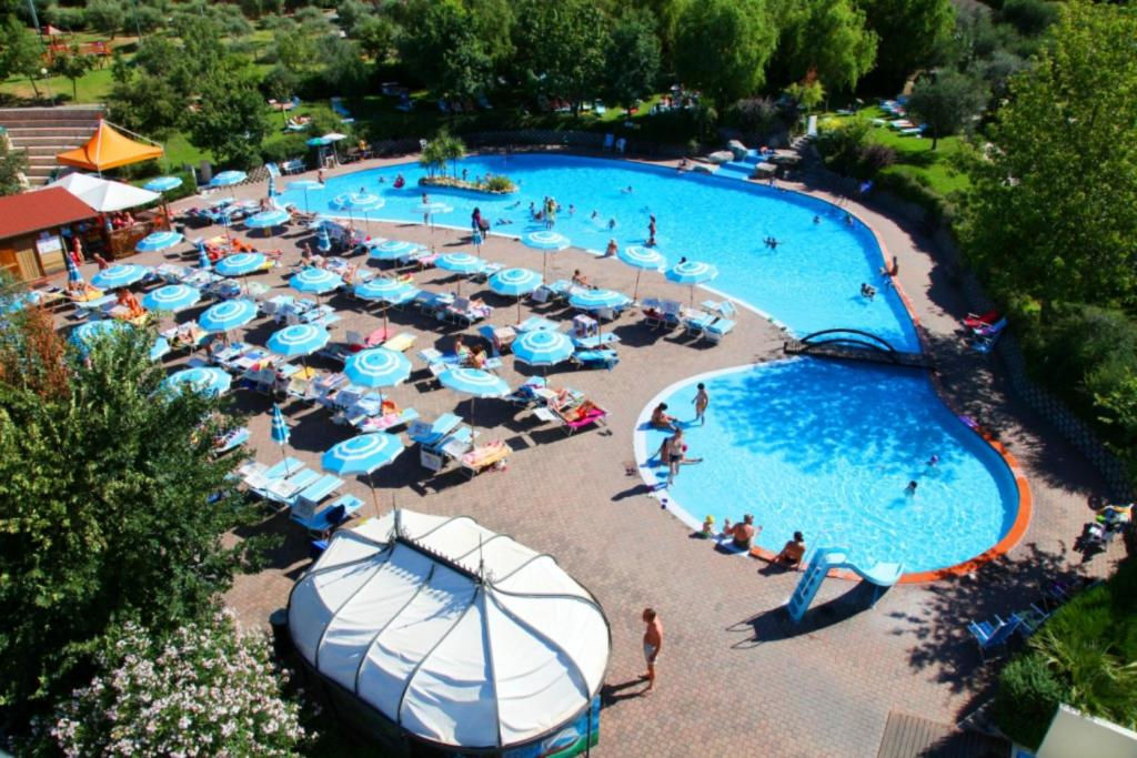 A view of the pool at Garden Village San Marino or nearby