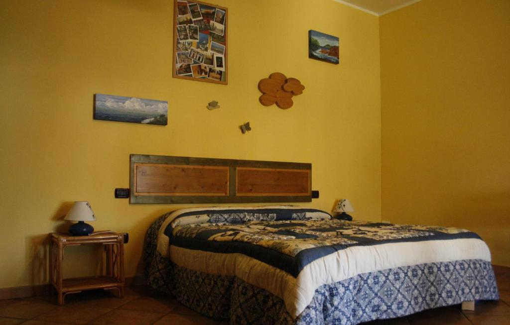 A bed or beds in a room at Le Storie di Bambu