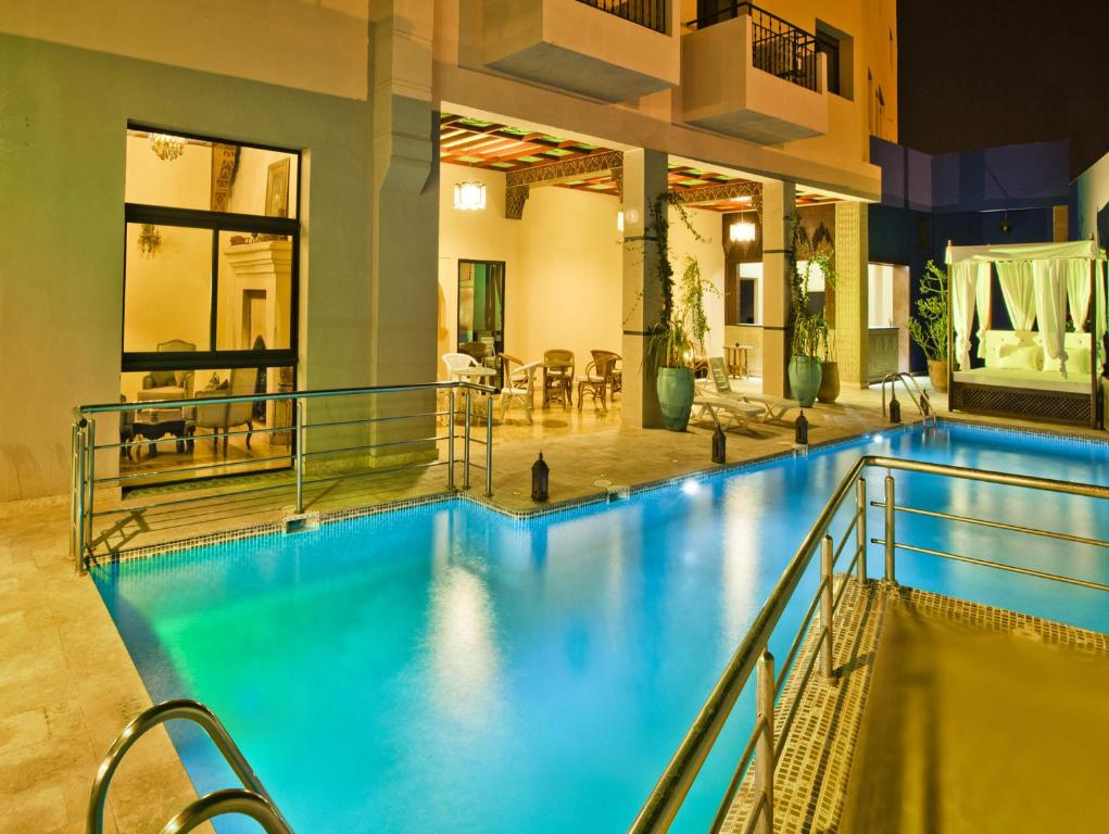 The swimming pool at or near Hotel Lawrence d'Arabie