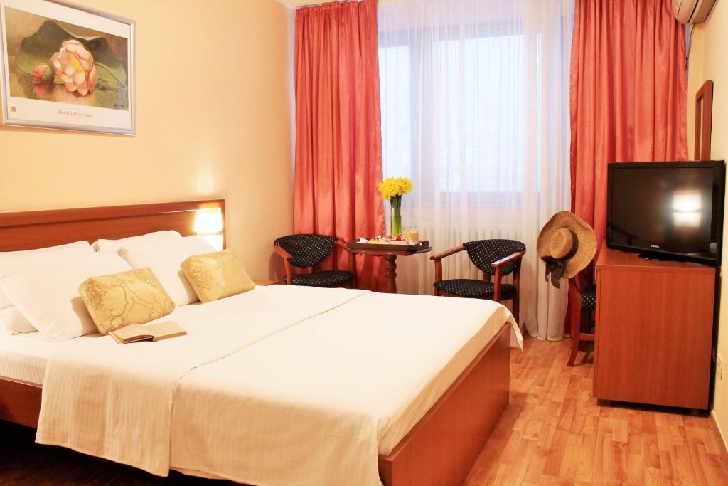 Кровать или кровати в номере Hotel Rex