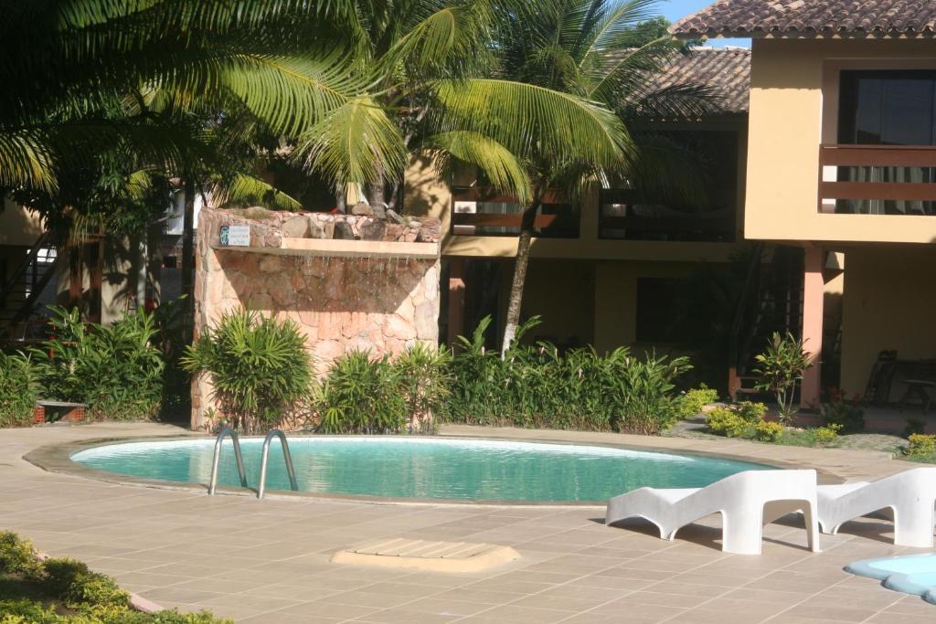 The swimming pool at or near Pousada Aldeia Mar