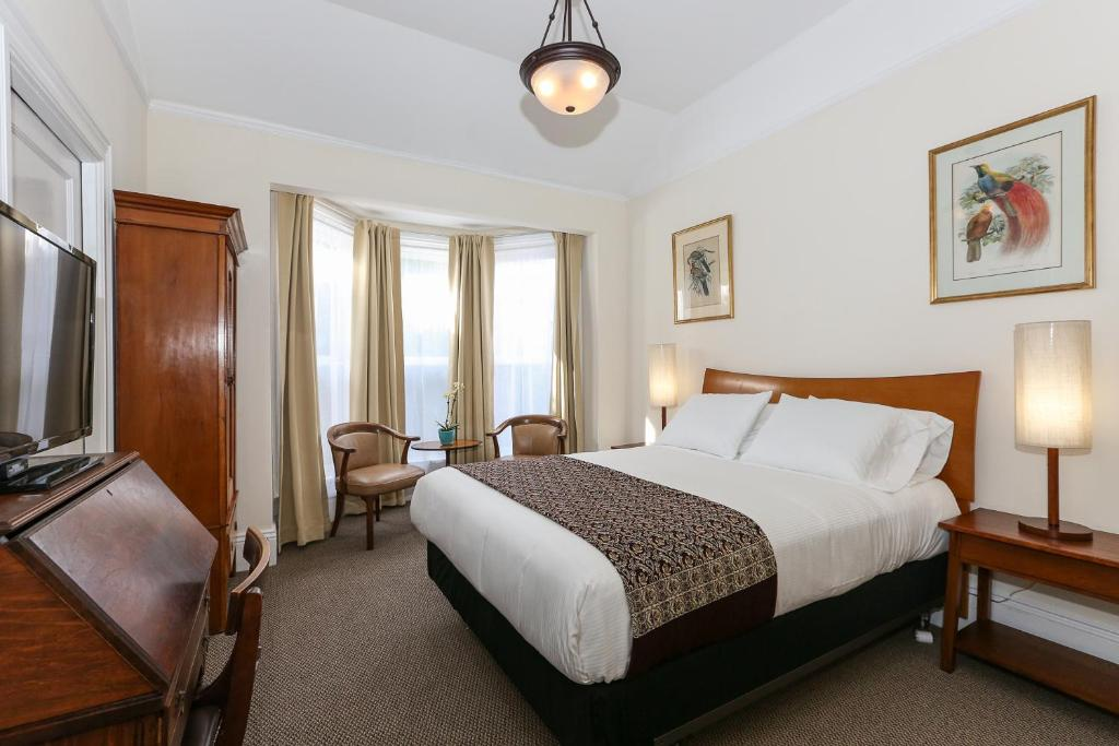 A bed or beds in a room at The Grove Inn