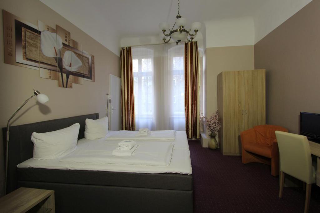 Ein Bett oder Betten in einem Zimmer der Unterkunft City Hotel Gotland