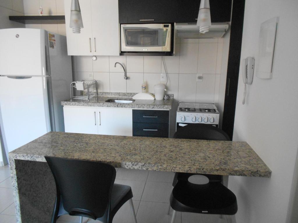 A cozinha ou cozinha compacta de Apartamento Monte Paradiso