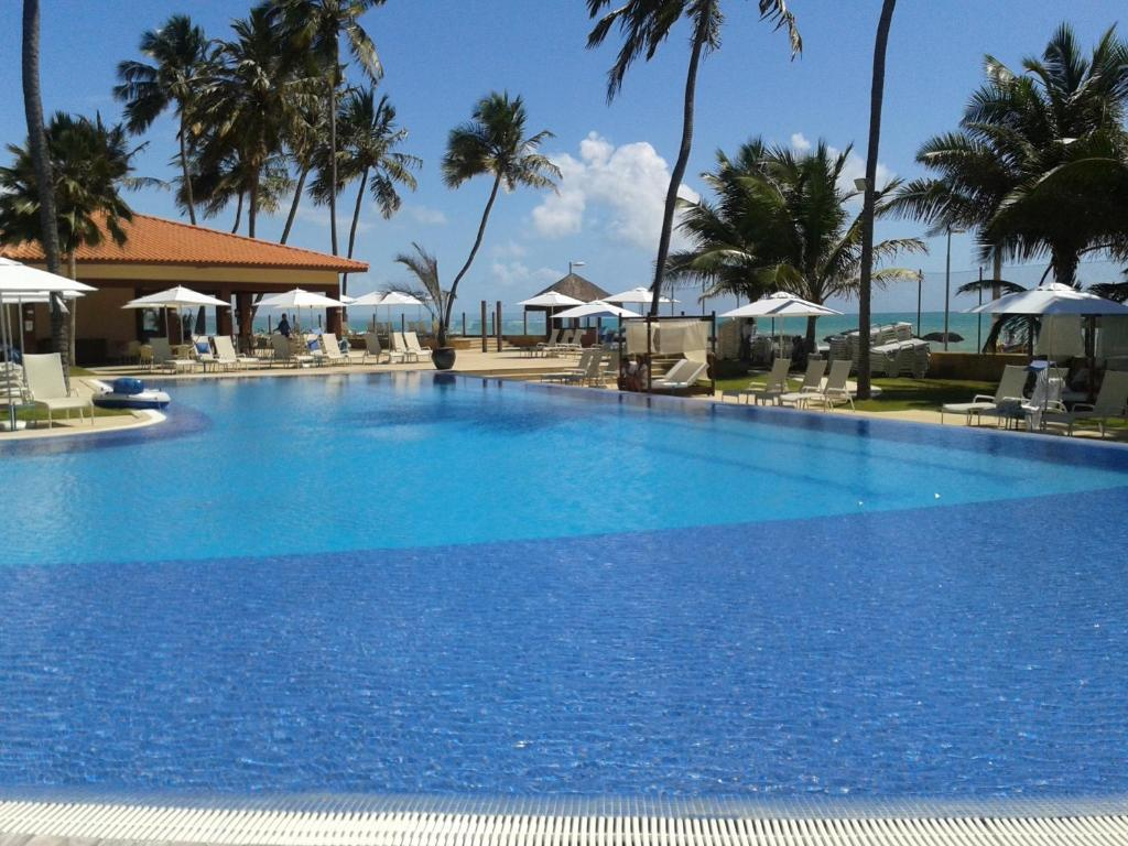 The swimming pool at or close to Jatiúca Resort Flat 404