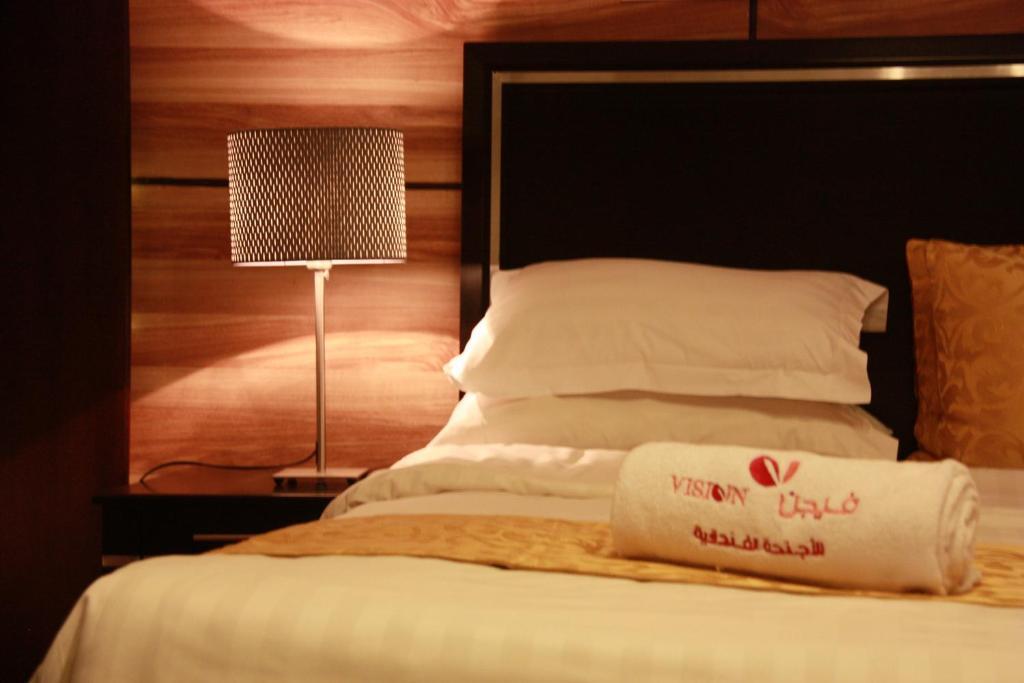 Cama ou camas em um quarto em Vision Apartment