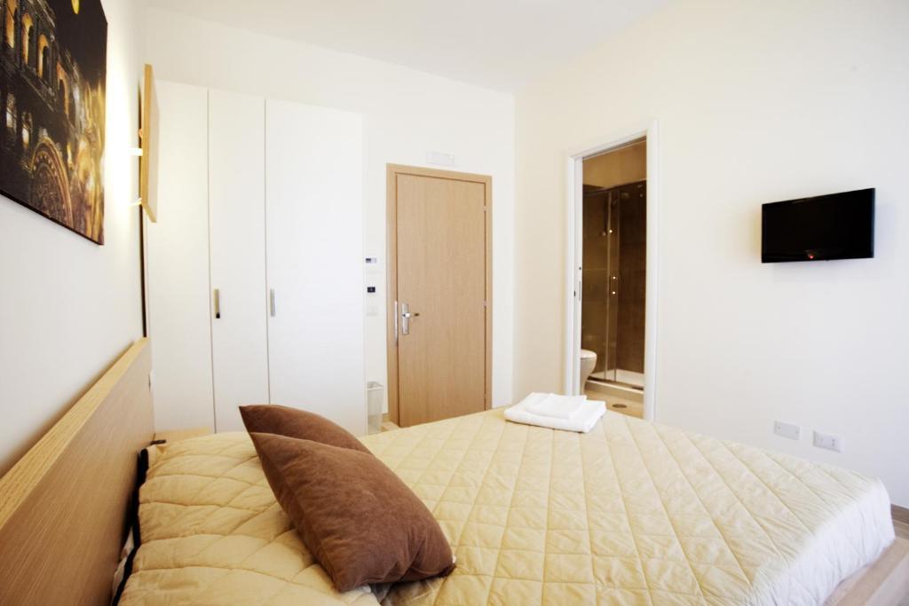 Un ou plusieurs lits dans un hébergement de l'établissement Affittacamere Nansen