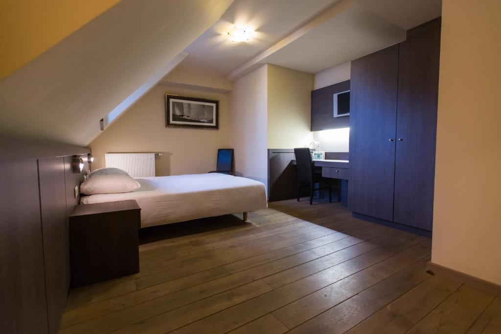 Кровать или кровати в номере Hotel De Spaenjerd