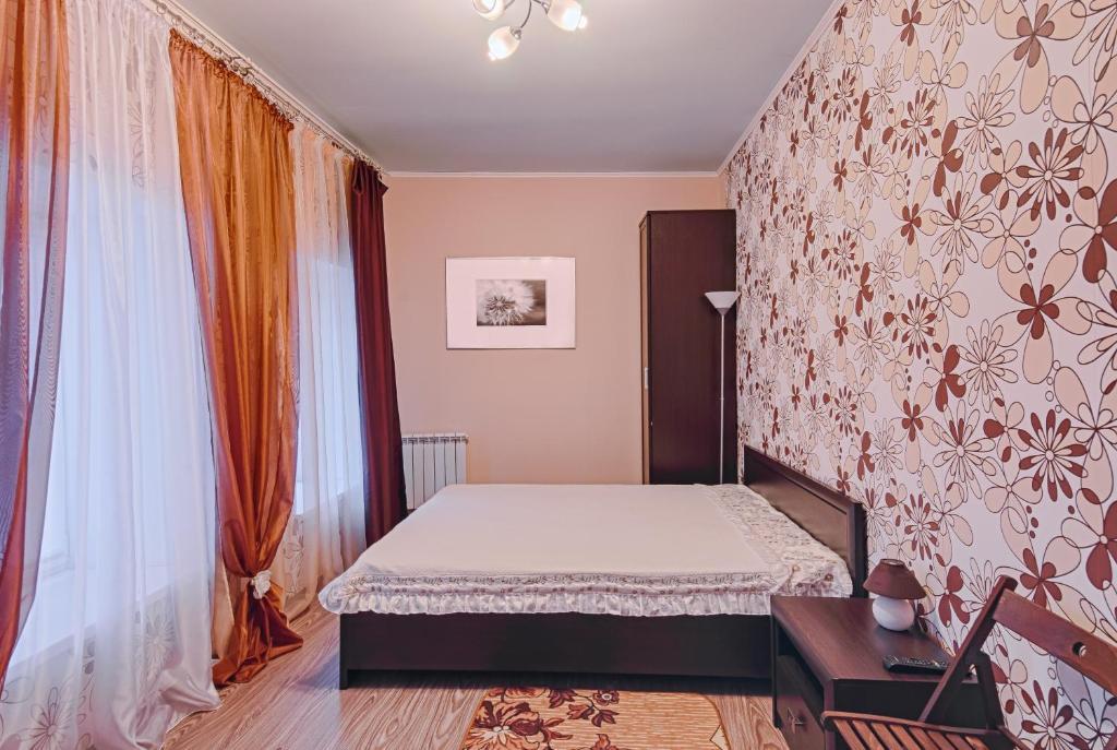 Кровать или кровати в номере Базилик Елец