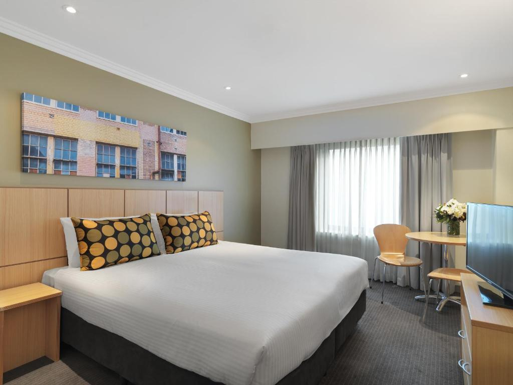 A bed or beds in a room at Travelodge Hotel Sydney