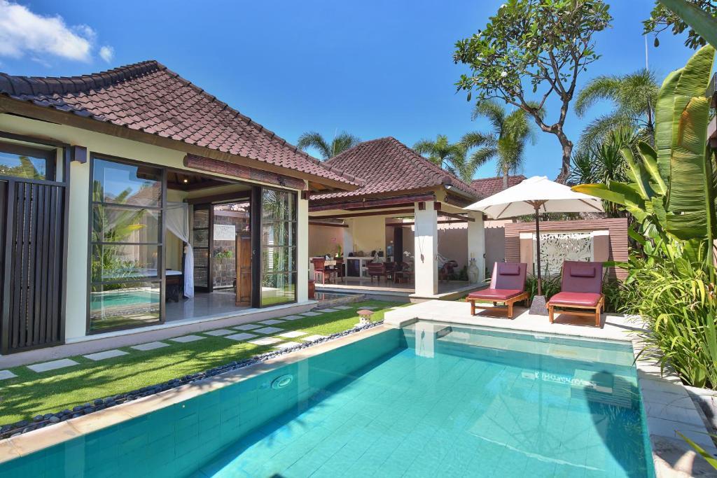 The swimming pool at or near The Bli Bli Villas & Spa