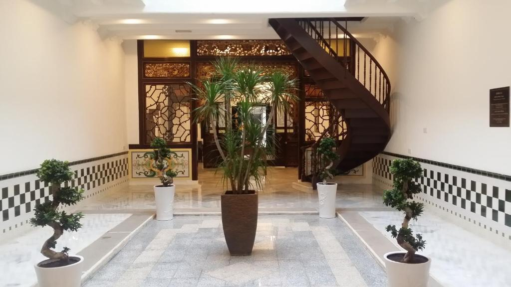 The lobby or reception area at Heeren Palm Suites