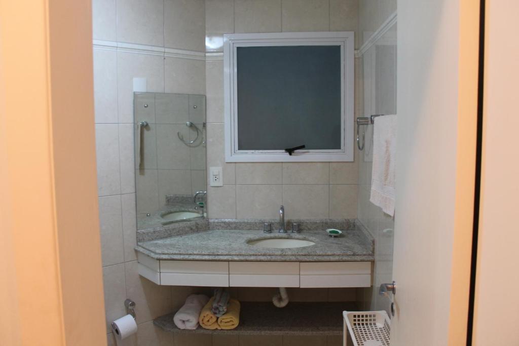 Um banheiro em Via Vecchia Jurerê Internacional