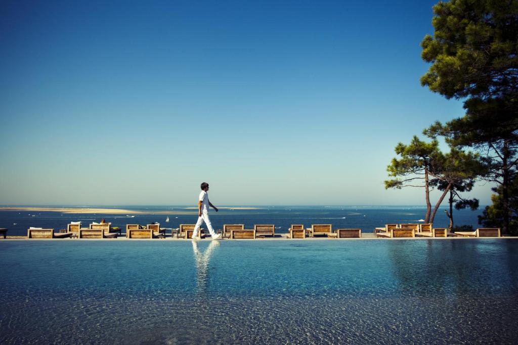The swimming pool at or near Hotel La Co(o)rniche
