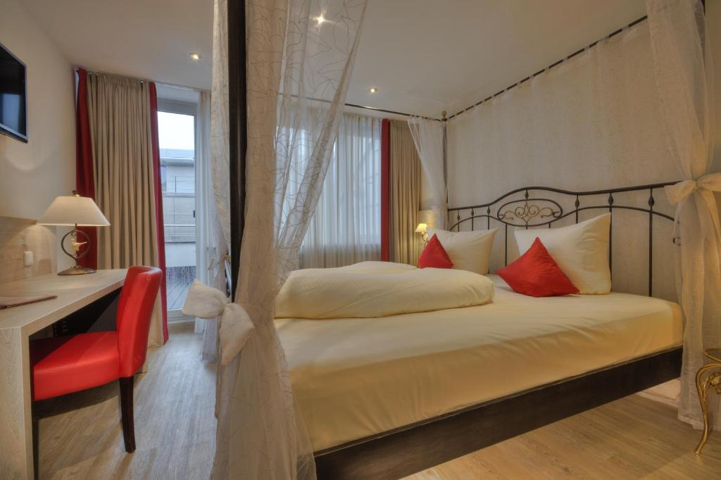 A bed or beds in a room at Hotel Condor