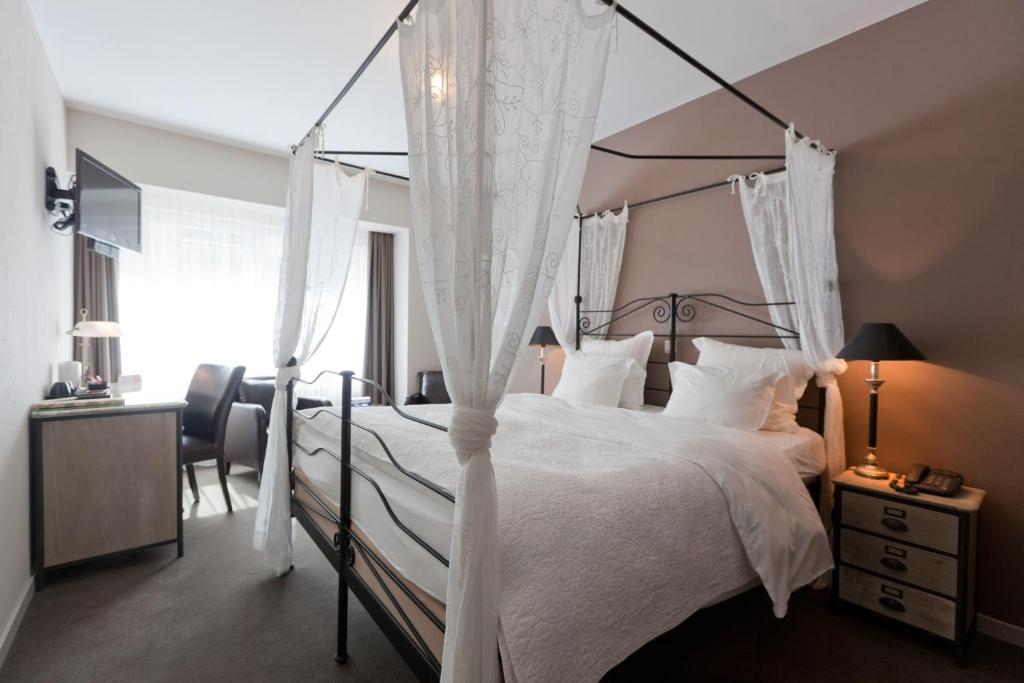 Ein Bett oder Betten in einem Zimmer der Unterkunft Hotel De Hofkamers