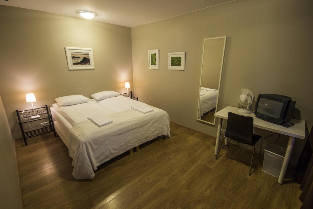 Кровать или кровати в номере Lyngás Guesthouse