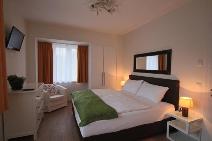Postel nebo postele na pokoji v ubytování Bella Vista Appartements by Schladming-Appartements