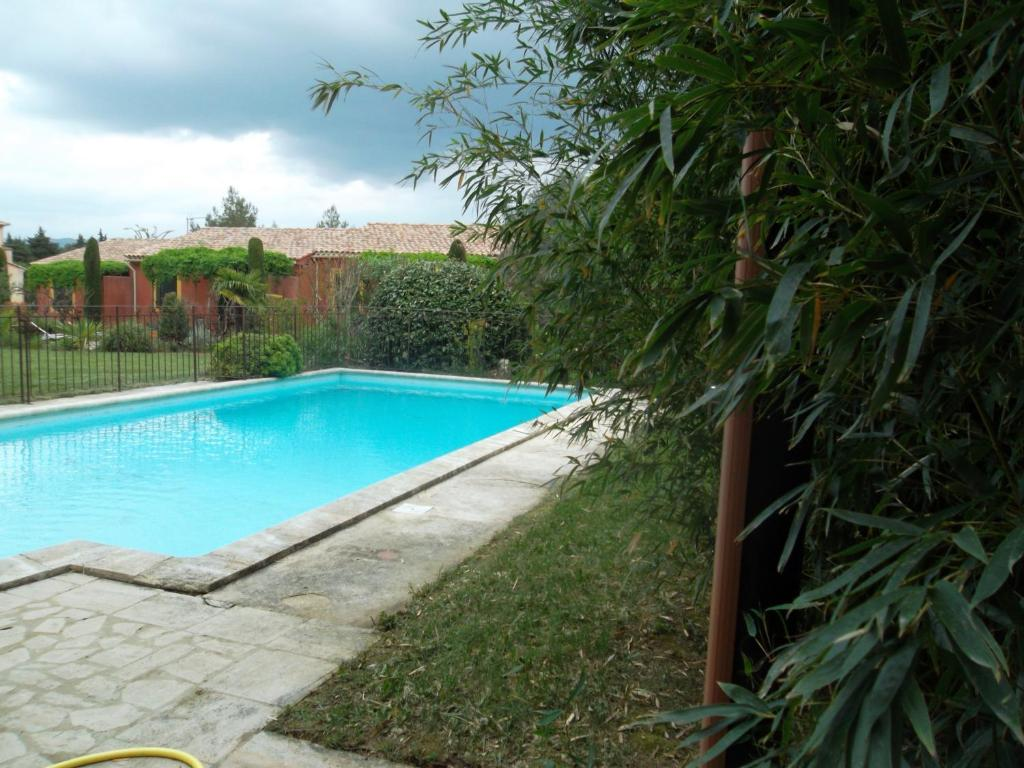 The swimming pool at or near Les Bastidons d'Angèle