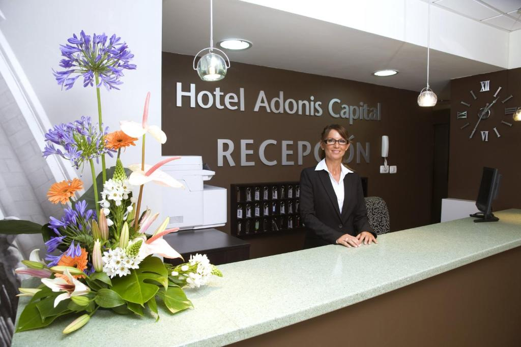 The lobby or reception area at Hotel Adonis Capital
