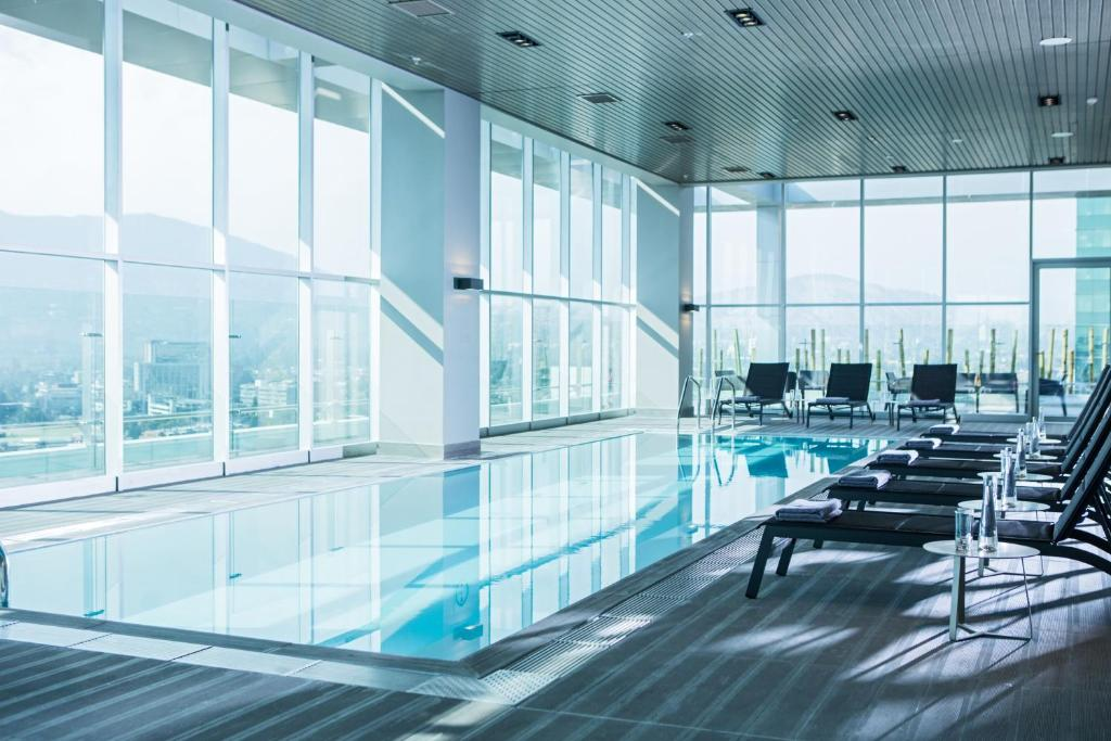 The swimming pool at or near Courtyard by Marriott Santiago Las Condes