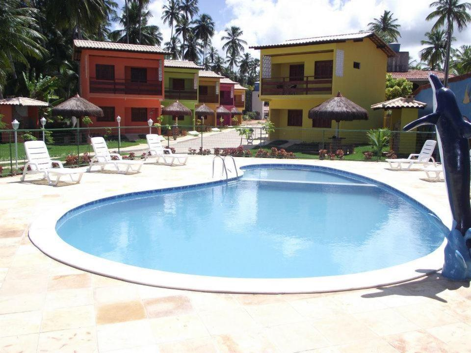 The swimming pool at or near Residencial Maragogi