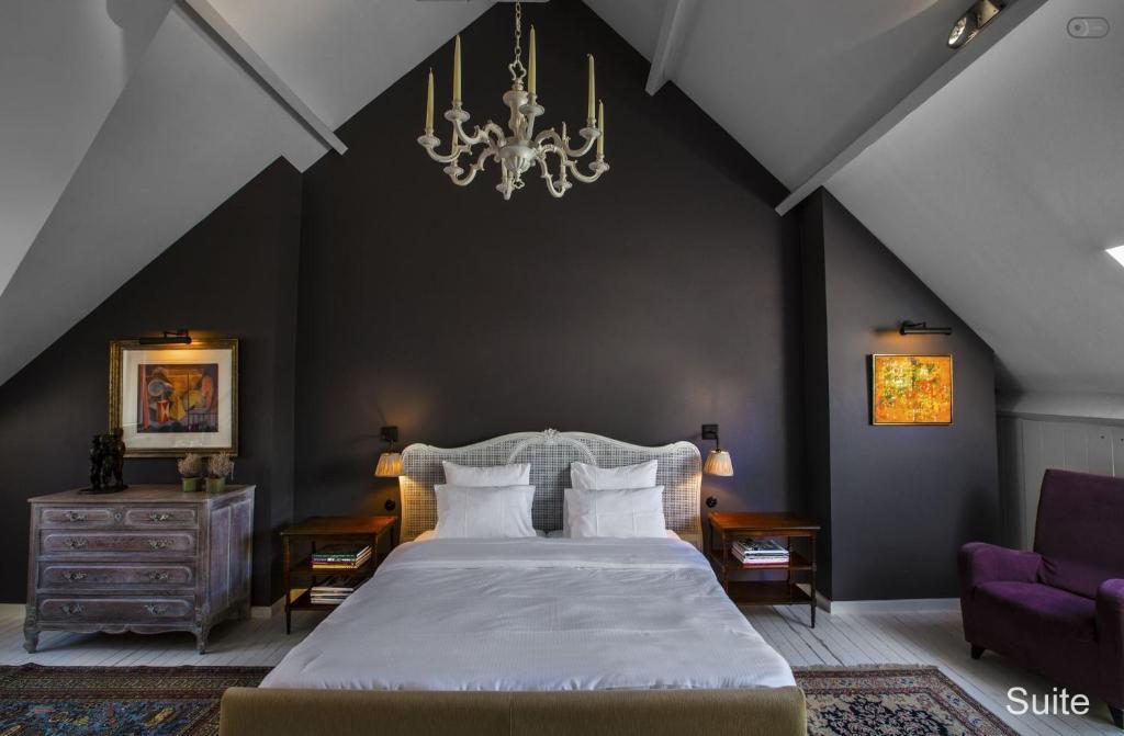 Un ou plusieurs lits dans un hébergement de l'établissement B&B Huyze Elimonica