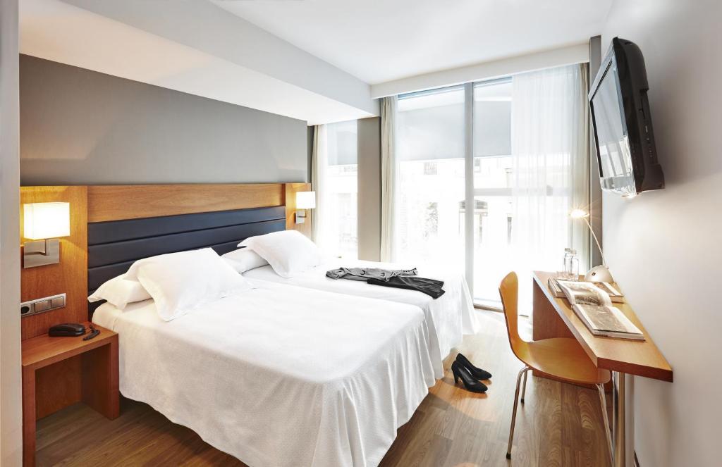 Letto o letti in una camera di Barcelona Century Hotel