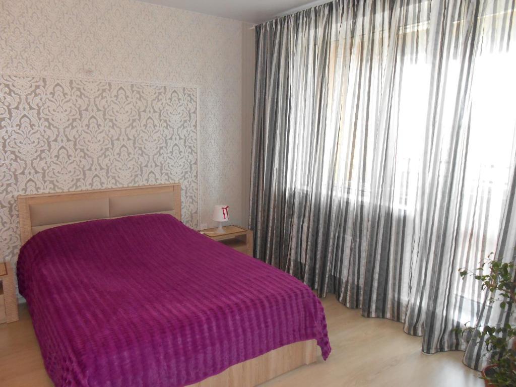 Кровать или кровати в номере Red avenue