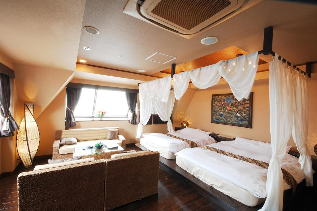 A bed or beds in a room at Hotel Balian Resort Chiba Chuo (Adult Only)