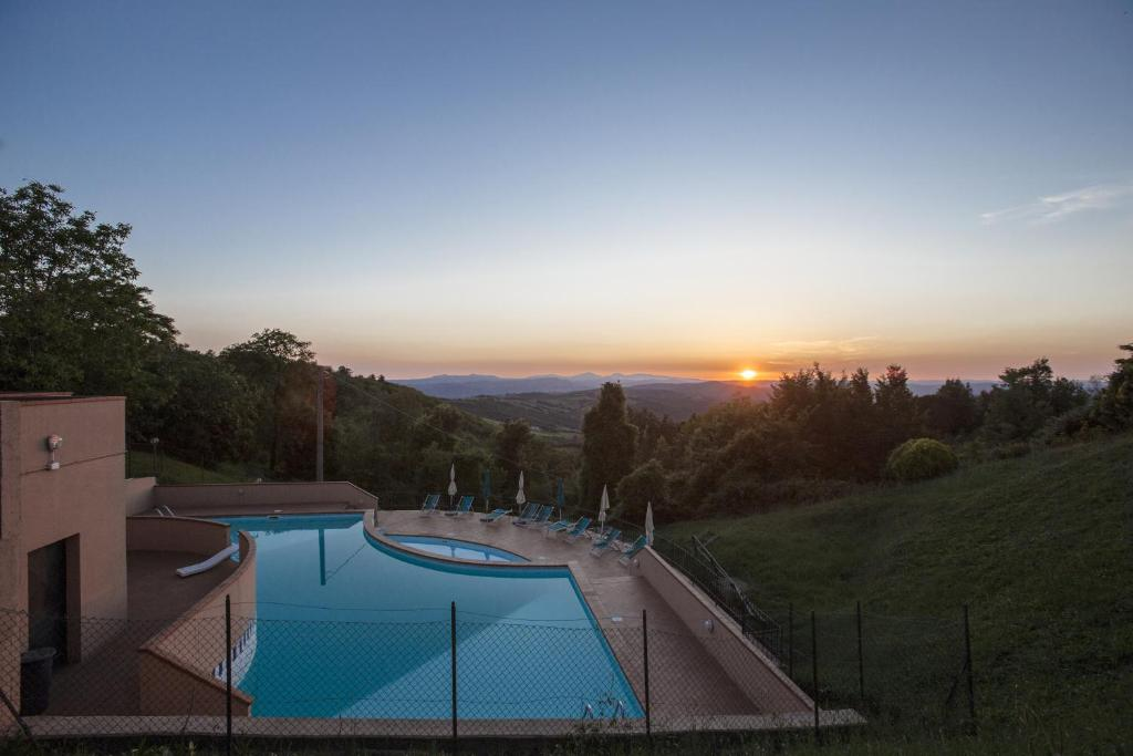 The swimming pool at or near Hotel Ristorante al Brunello di Montalcino