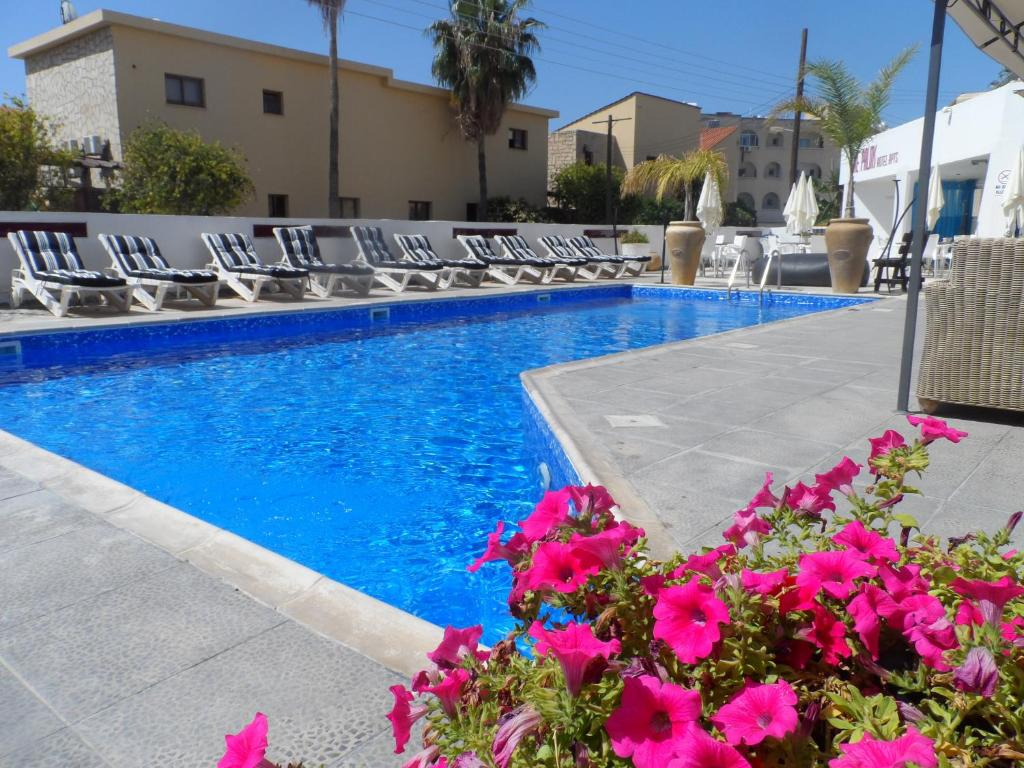 The swimming pool at or near The Palms Hotel Apartments