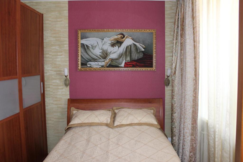Кровать или кровати в номере Апартаменты на Арбате