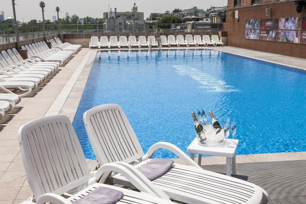 The swimming pool at or near Hamilton Hotel