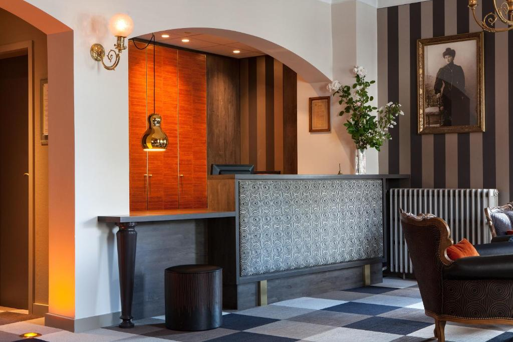 The lobby or reception area at Hotel Beausejour Colmar