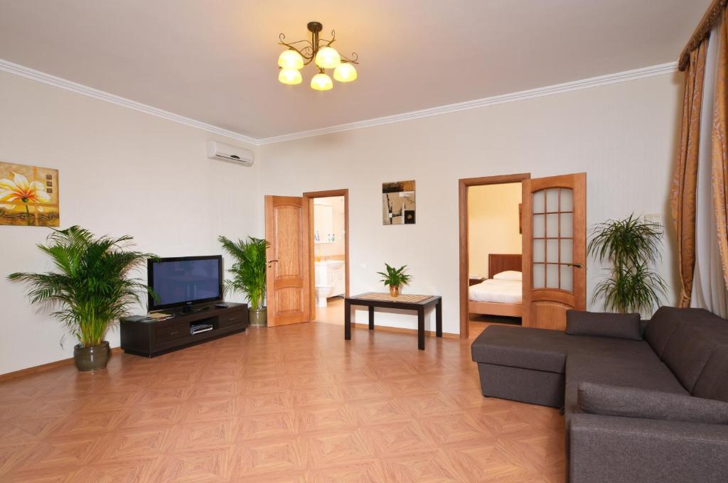 Зона вітальні в Botanic Apartments Krasnoarmeyskaya