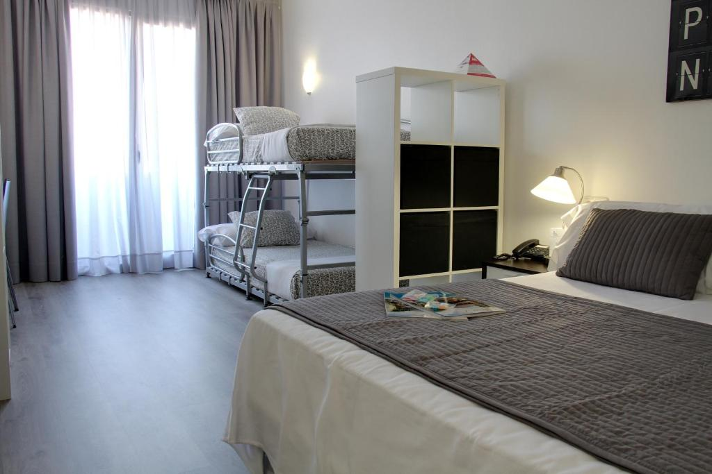 A bunk bed or bunk beds in a room at Aparthotel Atenea Calabria