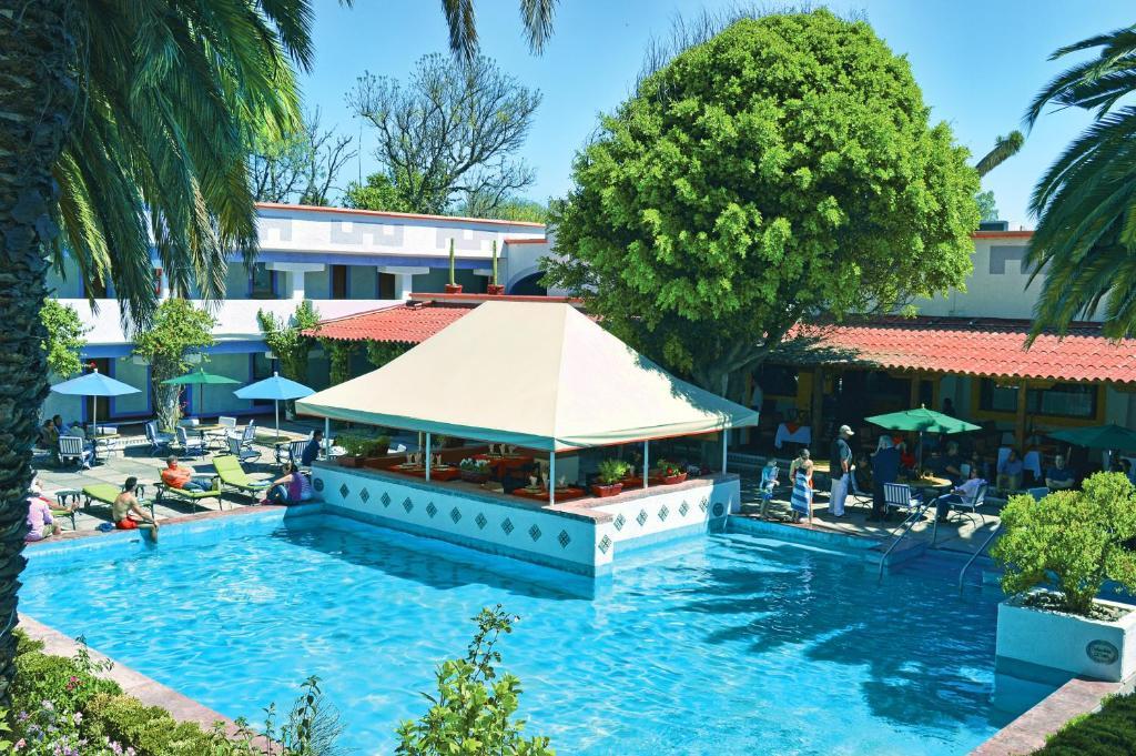 Piscina en o cerca de Villas Teotihuacan Hotel & Spa