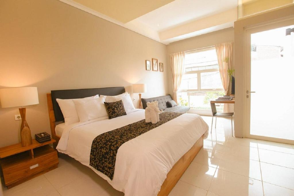 A bed or beds in a room at Bali True Living