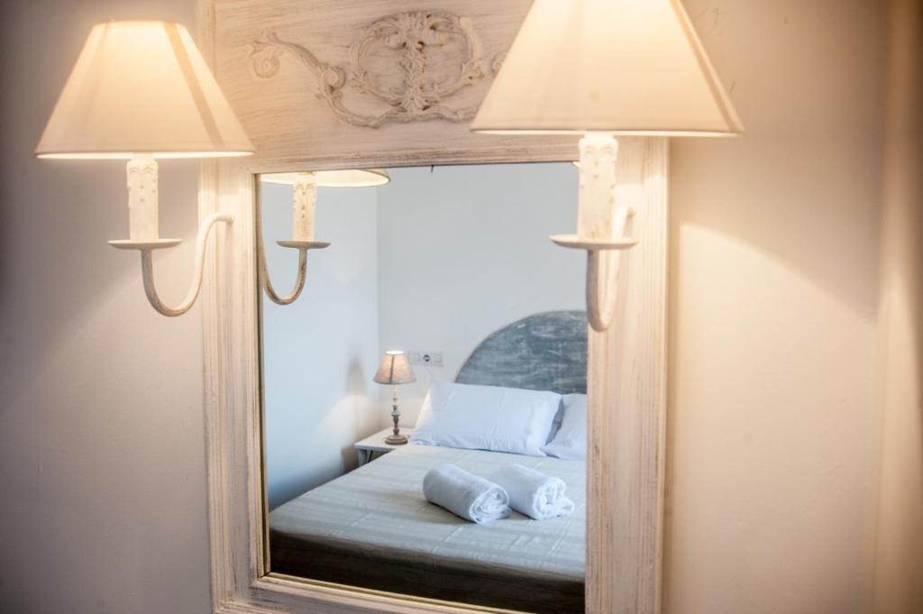 Cama o camas de una habitación en Hostal Bon Sol