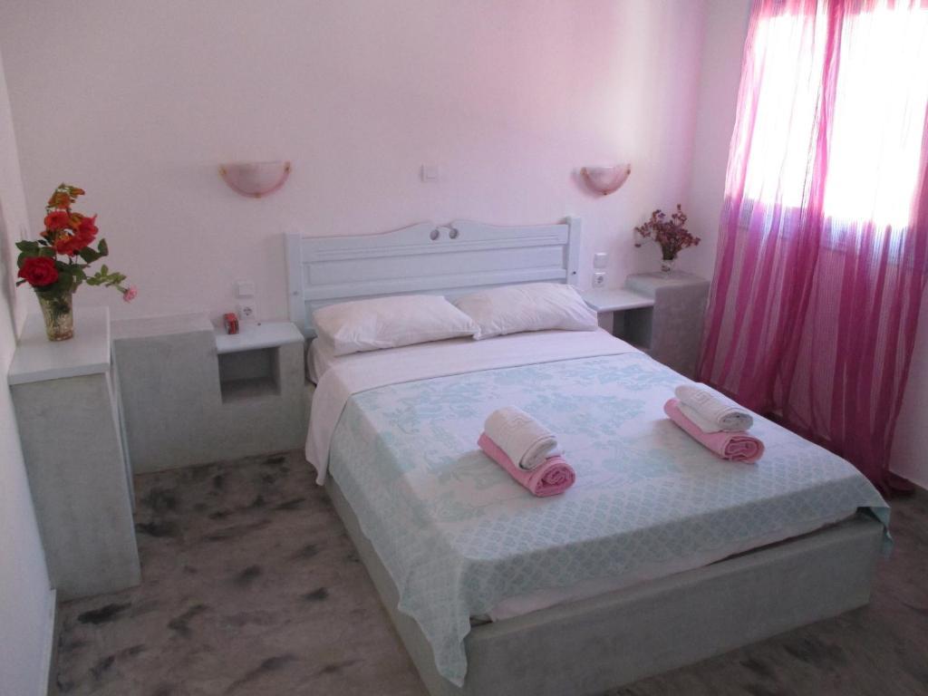 Ένα ή περισσότερα κρεβάτια σε δωμάτιο στο Skyros Junior Studios