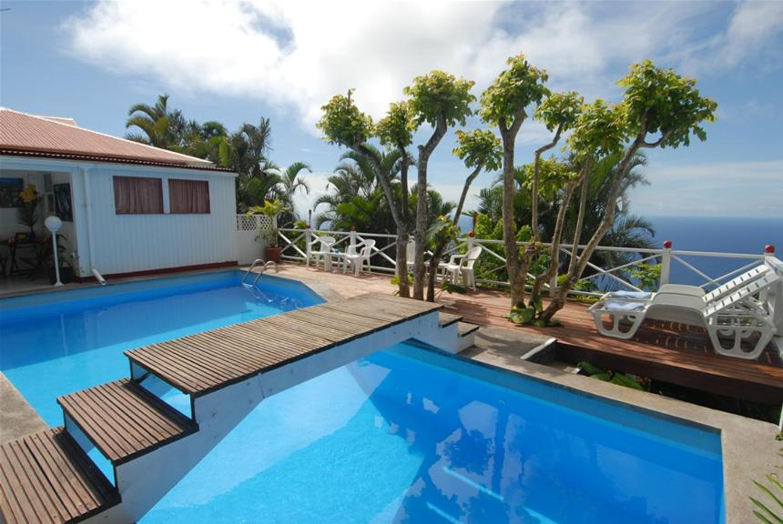 The swimming pool at or near El Momo Cottages