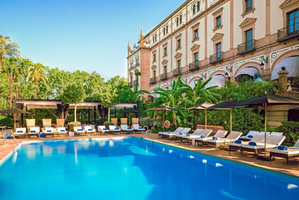 The swimming pool at or near Hotel Alfonso XIII, a Luxury Collection Hotel, Seville